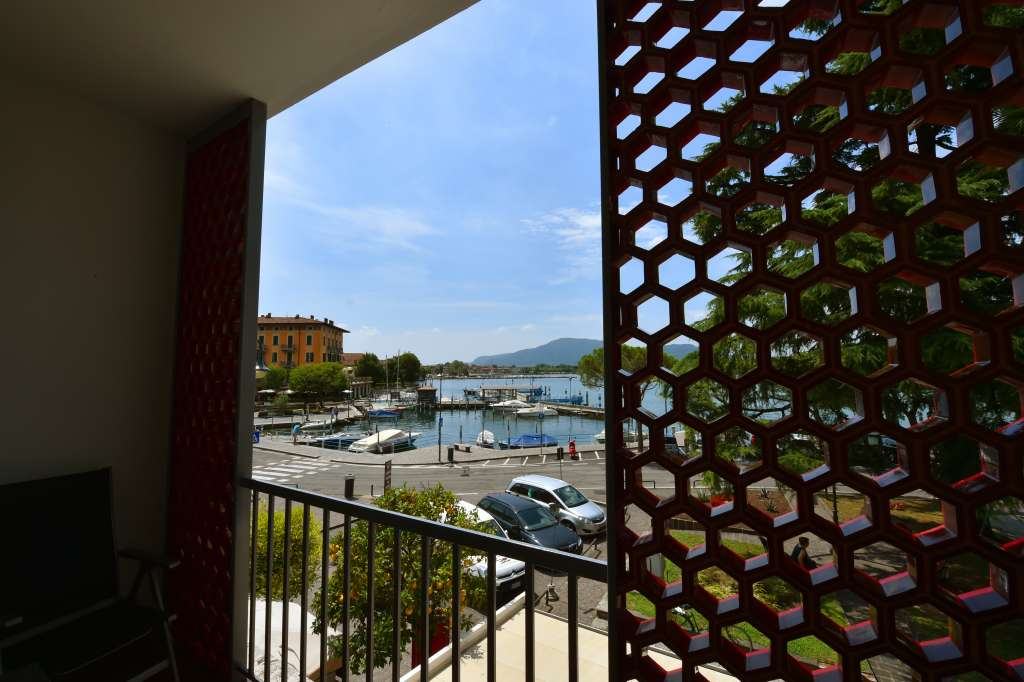 balcony with harbour view in lake iseo